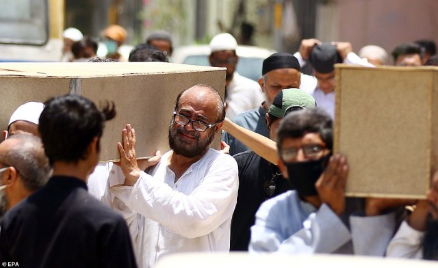 Relatives attend the funeral of the victims a day after a passenger plane of state run Pakistan International Airlines, crashed on a residential colony, in Karachi, Pakistan today