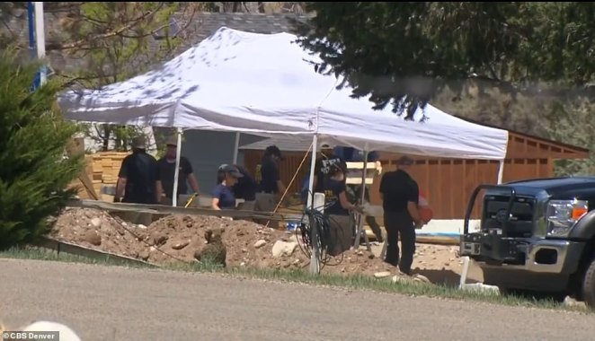 Agents from the FBI, the Colorado Bureau of Investigation and the Chaffee County Sheriff's Office were pictured Friday (above) sifting through buckets of newly-laid dirt and rubble they had dug up from the site's ground