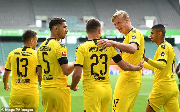 Dortmund players celebrate their first game, which put them on the path of three points
