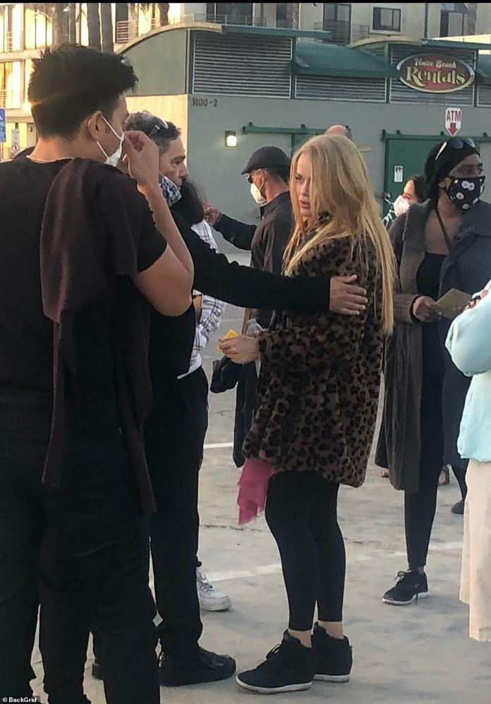 The mourners comforted the devastated widow of Shad who tragically lost her husband at the beach on Sunday