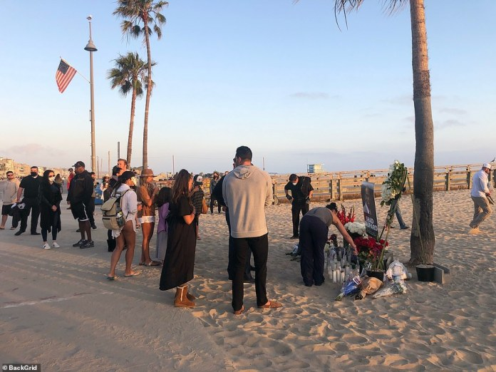 People gathered to pay tribute to the WWE star who tragically passed away this week during what was supposed to be a relaxing family day at the beach