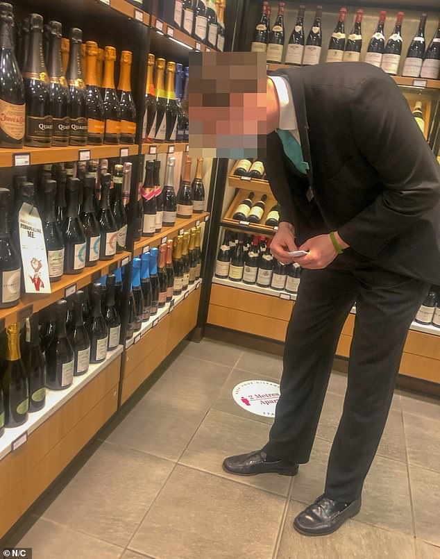 A customer looks at the Champagne on offer at the store today after the food hall reopened on Thursday