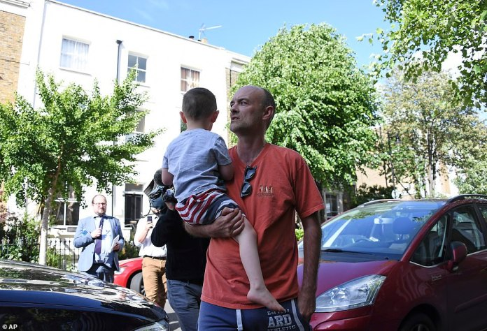 Mr. Cummings (pictured leaving home with son yesterday) insisted that he had the right to travel to family