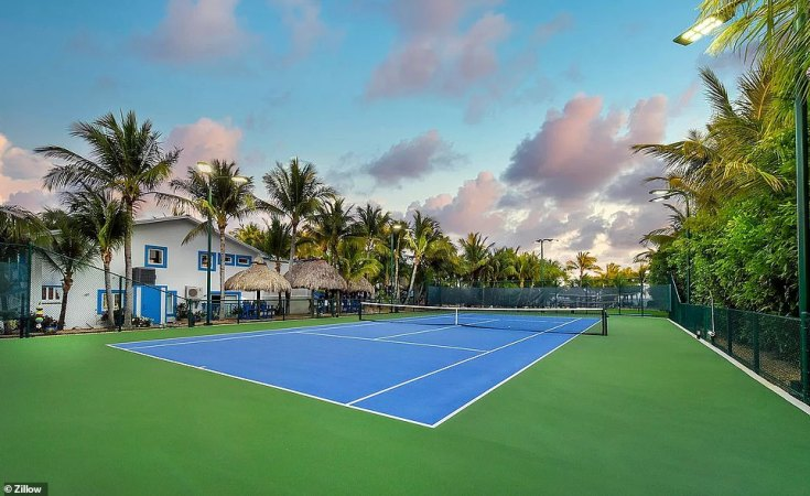 The $7.9million property also include a volleyball court, a tennis court (pictured above )and shuffleboard area
