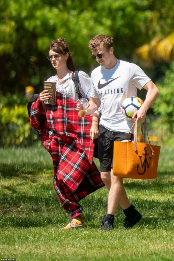 What a perfect day: Daisy Edgar-Jones, 22, and Tom Varey, 29, enjoyed a romantic picnic in a local London park on Thursday