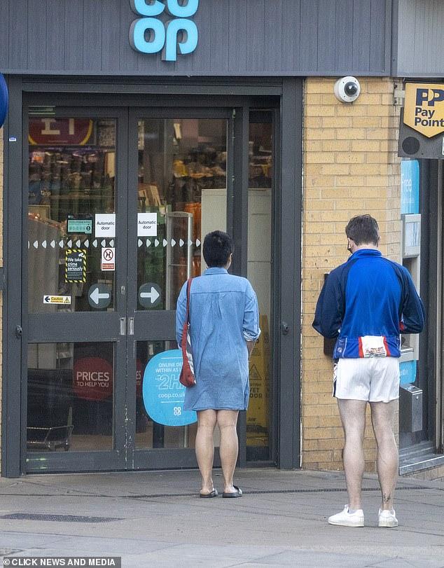 No diva: Despite his recent glory, Paul happily queued to enter his local supermarket