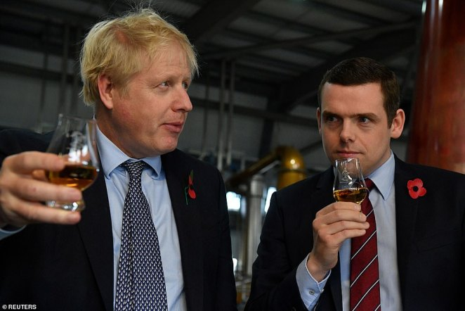 Douglas Ross, pictured with Boris Johnson during the general election campaign in November 2019, today resigned as junior Scotland minister over the Dominic Cummings lockdown row