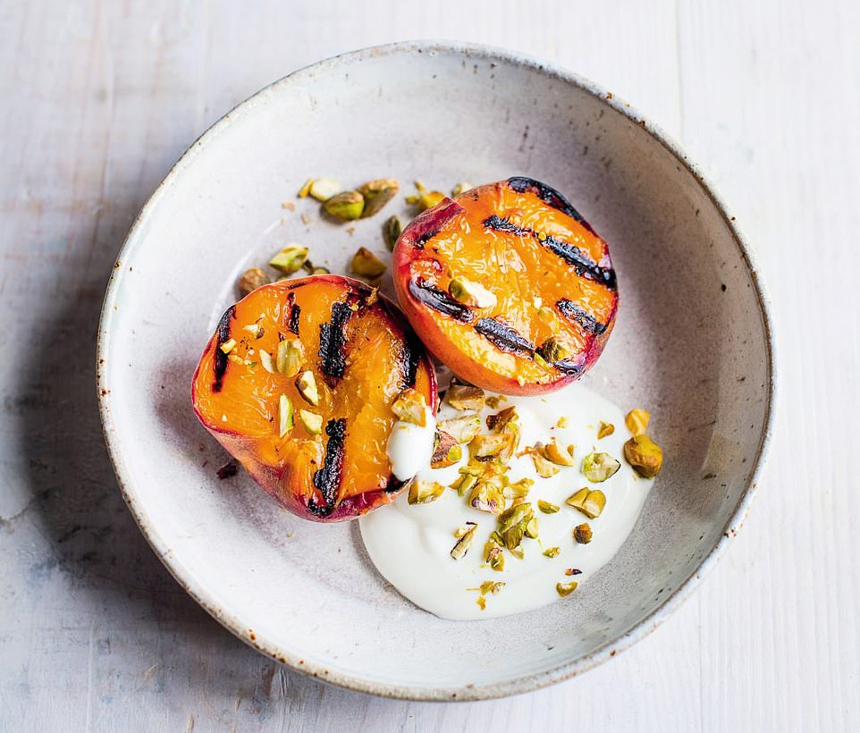 This indulgent seared peaches with yoghurt and pistachios dessert is best served with nuts