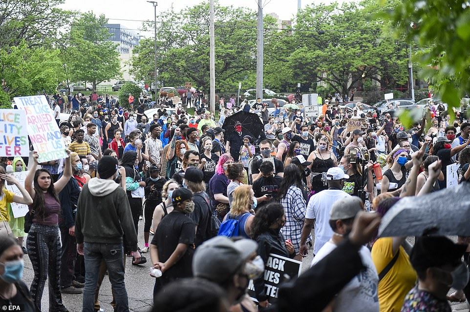 Flocks of people gathered to demand action against the white cops at the center of Floyd's death