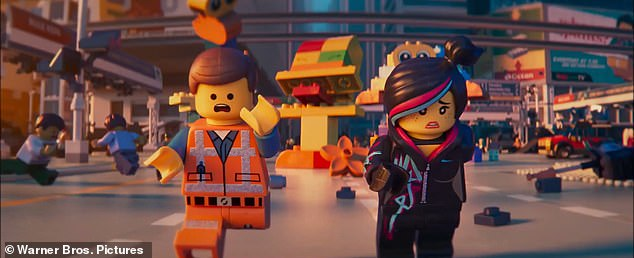Two characters from the LEGO movie run through the streets