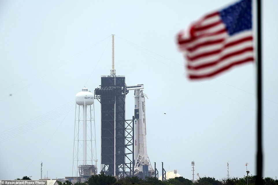 The SpaceX Falcon 9, with the Crew Dragon spacecraft on top of the rocket, sits on Launch Pad 39-A on Monday at Kennedy Space Center, Florida