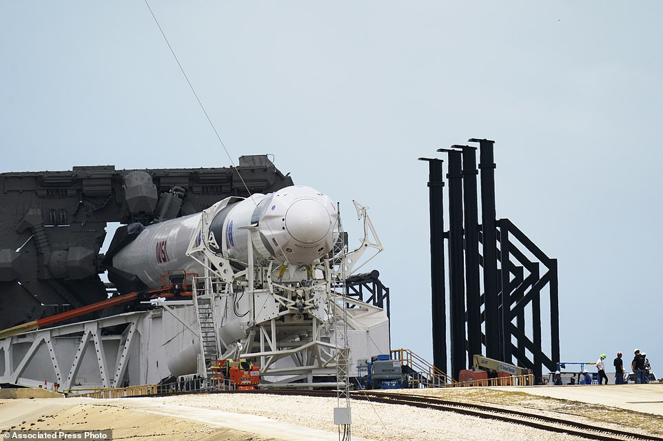 The SpaceX Falcon 9, with Dragon crew capsule is serviced on Launch Pad 39-A on Tuesday at the Kennedy Space Center in Cape Canaveral, Florida