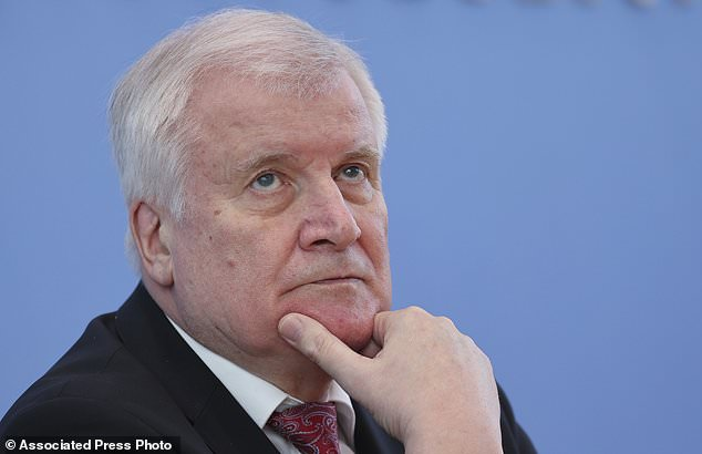 German Interior Minister Horst Seehofer, attends a news conference on politically motivated crimes in Berlin on Wednesday, May 27