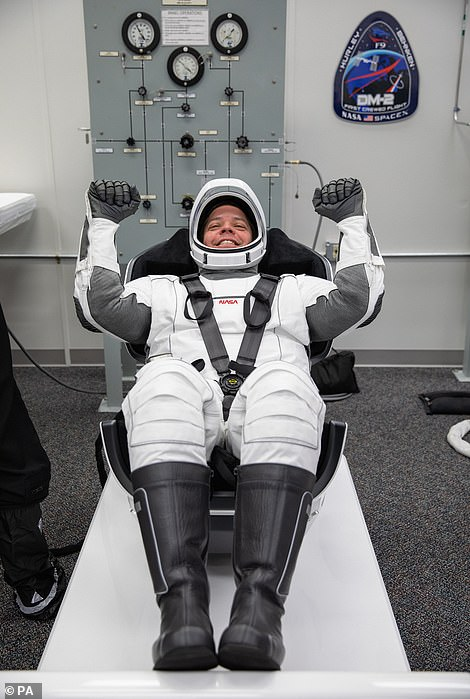 The boots are part of the suit, but are made of a black material to give the appearance of traditional boots. Each suit is custom made for its astronaut.