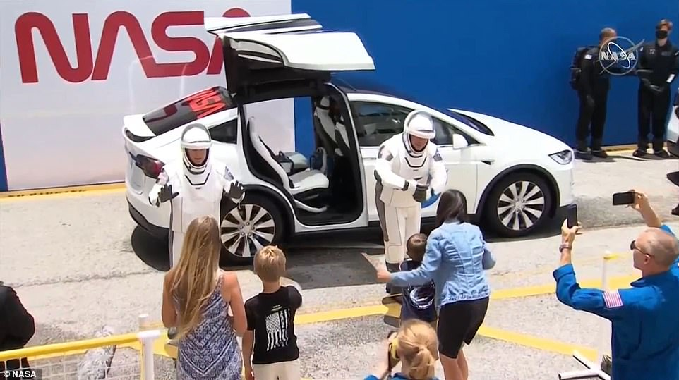 NASA astronauts Bob Behnken and Doug Hurley said goodbye to their families and then boarded a Tesla Model X, which is the other company associated with SpaceX founder Elon Musk