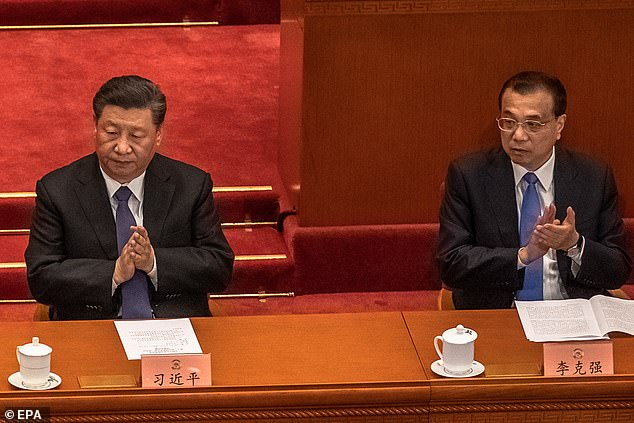 The Chinese National People's Congress passed the national security law for Hong Kong unanimously at its closing ceremony in Beijing on Thursday. Pictured,Chinese President Xi Jinping (left) and Premier Li Keqiang (right) applaud during the closing session of the Chinese People's Political Consultative Conference (CPPCC) in Beijing on 27 May