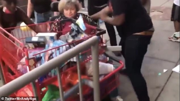 People could be heard screaming as the woman was pushed around and nearly tipped over