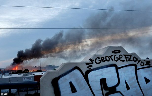 Smokes was seen filling the sky in city early Thursday after chaos erupted on the streets for a second night
