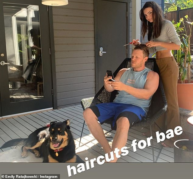 Quarantine cut: Emily Ratajkowski showed of her hair skills Thursday as she took to her Instagram story after giving husband Sebastian Bear-McClard a cut on the patio of their Los Angeles home