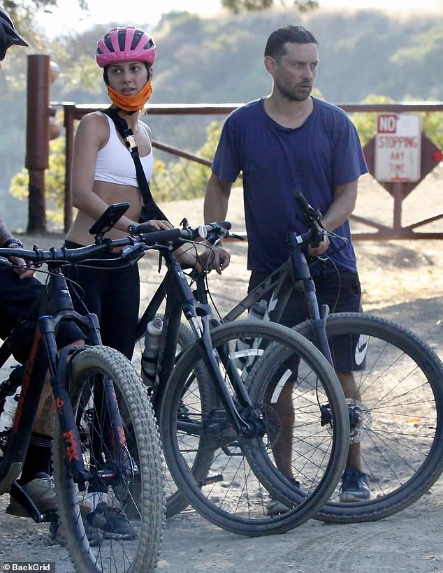 Make way:Tobey Maguire made the most of rising spring temperatures on Thursday as he ventured out for a bike ride with model girlfriend Tatiana Dieteman