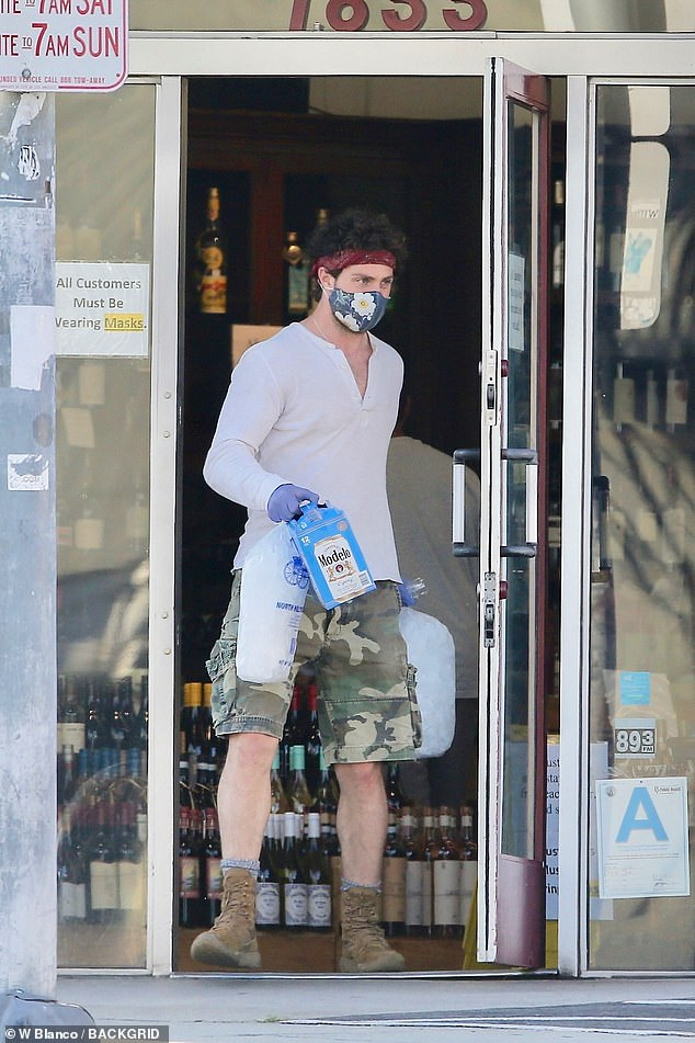 Lockdown look: Sam Taylor-Johnson stepped out in a white shirt, cargo shorts and boots as he headed to the shops on Thursday in Los Angeles