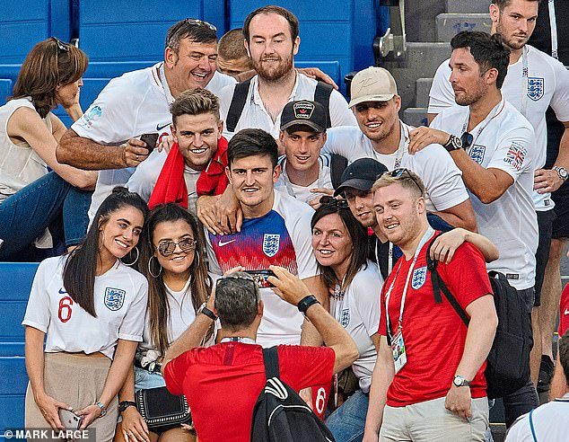 Harry Maguire pictured with family and friends, including his brother Laurence (left of Maguire) and Jake Beesley (right of Maguire), at the 2018 World Cup in Russia