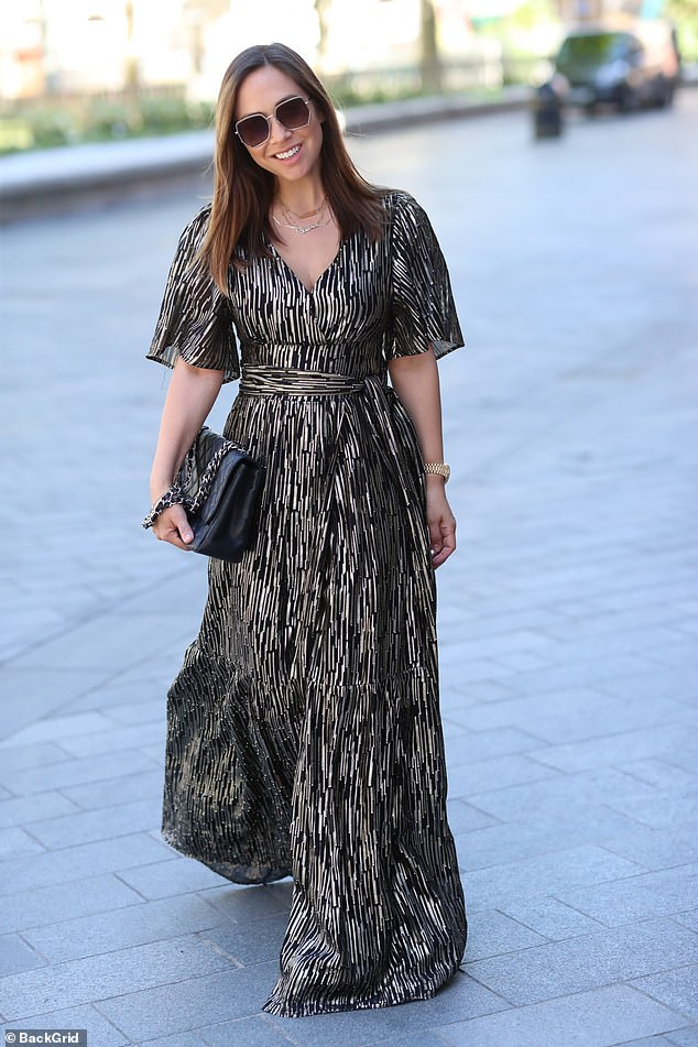 Full of the joys:Myleene was clearly in a chipper mood as she flashed a broad smile as she walked down the street