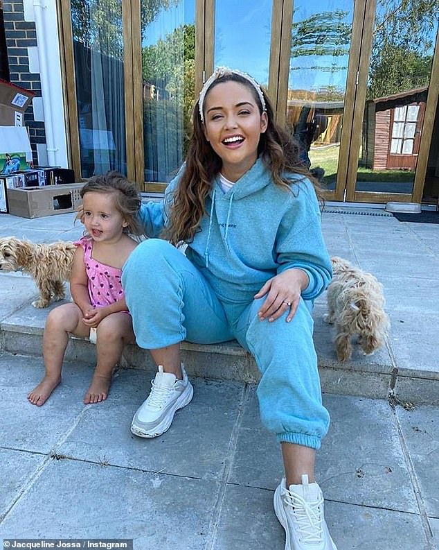 Good humor: Jacqueline demonstrated a challenge by going on Instagram Friday to share a sweet snapshot with her daughter Mia, 23 months, and her two dogs