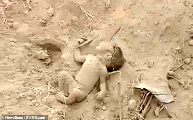After a few tense moments, the little boy begins to move his arms and legs, before the rescuers rush him to the hospital