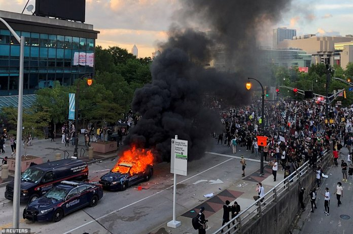 Atlanta: Police cruisers were set on fire as hundreds of protesters took to the streets of Atlanta