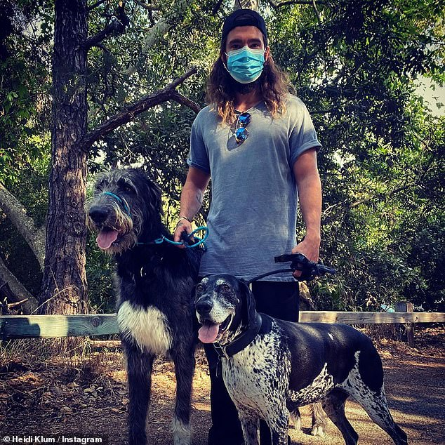 Figure: Another photo shows Tom - who is the lead guitarist for the German pop rock band Tokio Hotel - serving both of their dog reins