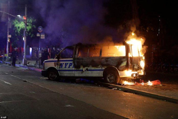 Brooklyn, New York:A burning police vehicle near the Barclays Center in the Brooklyn borough