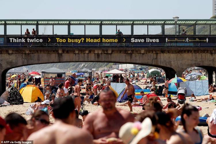 Crowds have flocked to Bournemouth beach on England's south coast ahead of lockdown measures being eased on Monday