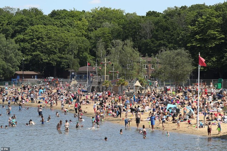 Ruislip Lido in London is packed today with social distancing appearing almost forgotten ahead of the more lockdown restrictions being eased by the government tomorrow