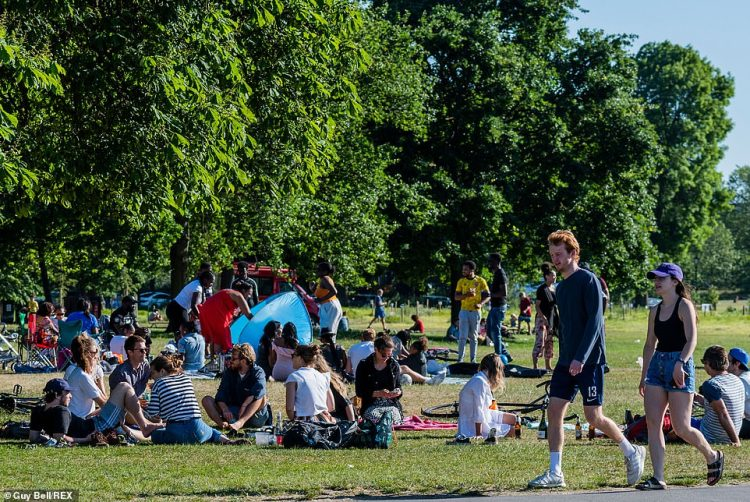 People enjoy the sun on Clapham Common after the Government eased restrictions and allowed people to meet from Monday