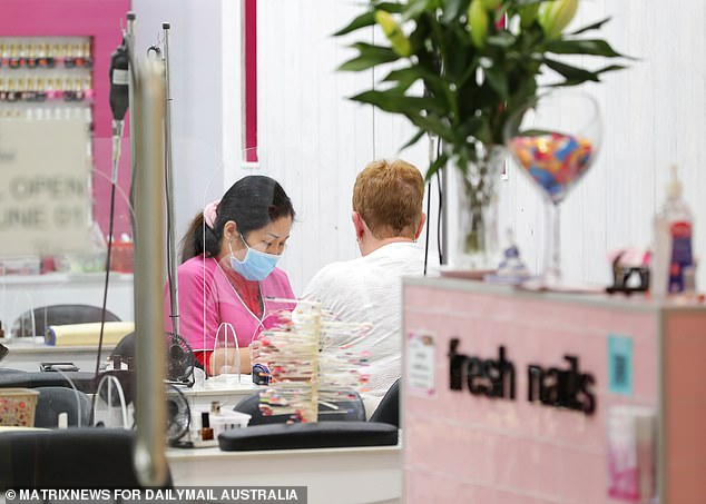 Pictured: One of the first customers to return to Fresh Nails in Stanhope Gardens for a manicure