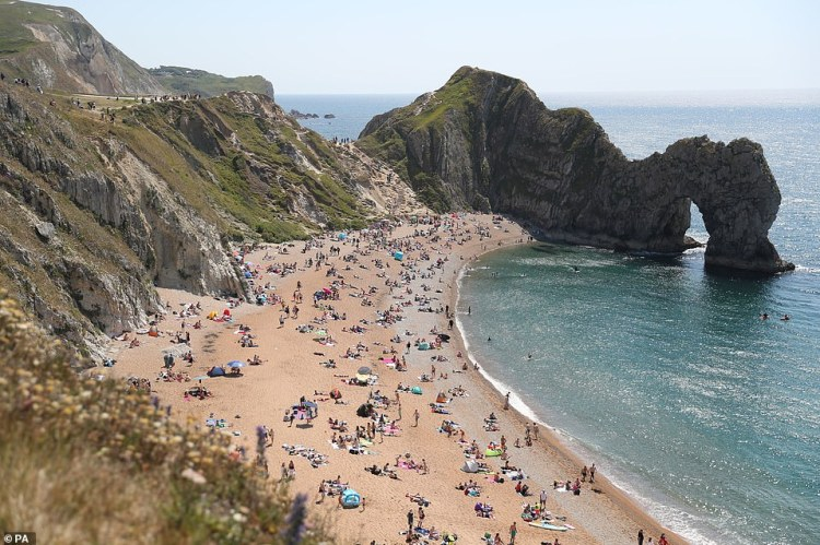 People fill the beach at Durdle Door, near Lulworth, today despite Dorset Council announcing that the beach was closed to the public