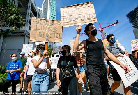 Taking part: Shawn Mendes, 21, and Camila Cabello, 23, joined protestors at a peaceful demonstration in Miami on Monday with their own cardboard signs following the death of George Floyd