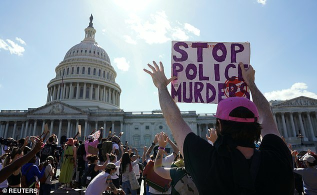 Demonstrators put up their hands to protest the death in Minneapolis police custody of George Floyd, at the U.S. Capitol in Washington (pictured on June 1)