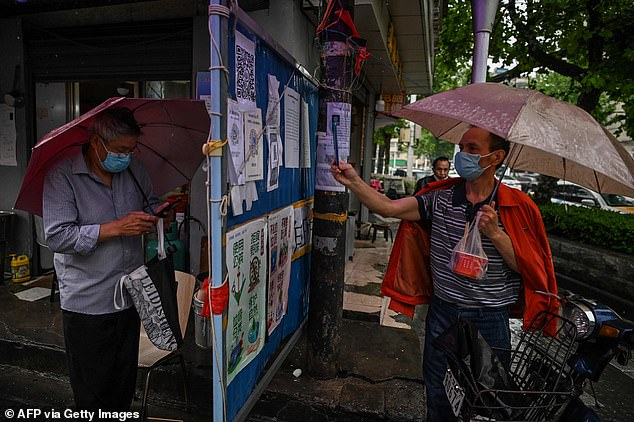 Wuhan has recorded a total of 50,340 confirmed COVID-19 cases and at least 3,869 deaths. More than 46,000 patients have been discharged from hospitals.People wearing face masks check a health code in a neighbourhood in Wuhan of China's central Hubei province on May 1