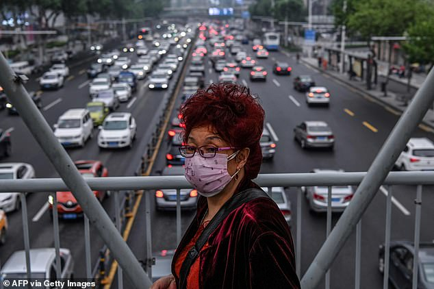 Wuhan has declared that zero confirmed COVID-19 infections was found after officials screened nearly 10million residents in 20 days during the city's mass testing to prevent a fresh outbreak.A woman wearing a face mask walks on a pedestrian bridge in Wuhan on May 14