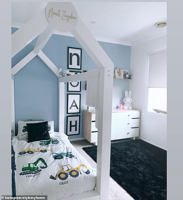 Meanwhile her son's bed has a custom made bed canopy with his name on it, letters running down the wall that also spell out his name, and a matching white set of drawers