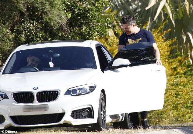 Off he goes: The 34-year-old cook was dressed casually as he jumped into his manager's white BMW