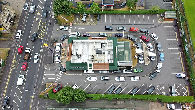 HUDDERSFIELD: An aerial shot shows cars circling a McDonald's in Huddersfield on June 3