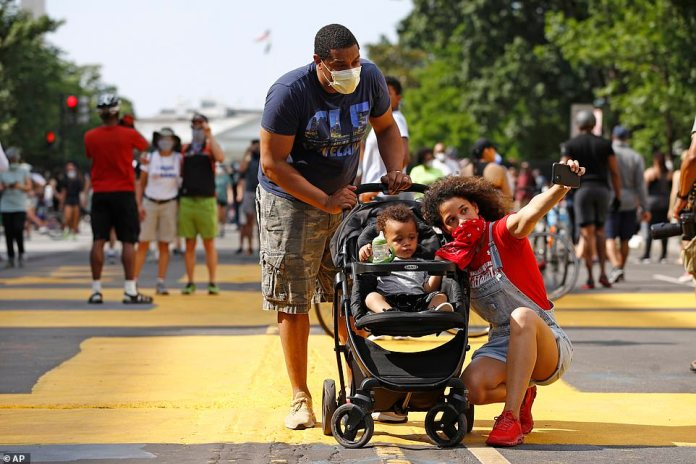 WASHINGTON, D.C .: A family of protesters gathers to take a photo during historic protests