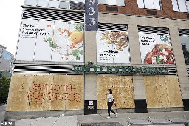 Graffiti on Manhattan food market reads June 2 on the