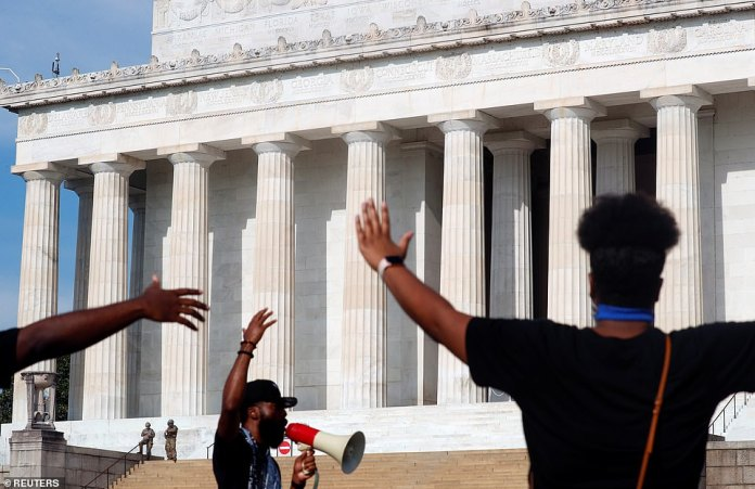 WASHINGTON, D.C .: People react as a preacher speaks to them as National Guard members stand near the Lincoln Memorial before the Black Lives Matter protests in Washington D.C. and across the country on Saturday