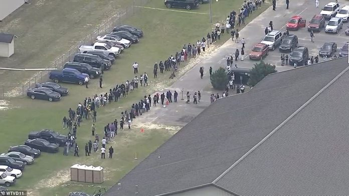 RAEFORD, NORTH CAROLINA: Floyd's body arrived at the center as long lines formed and people came to pay homage to them