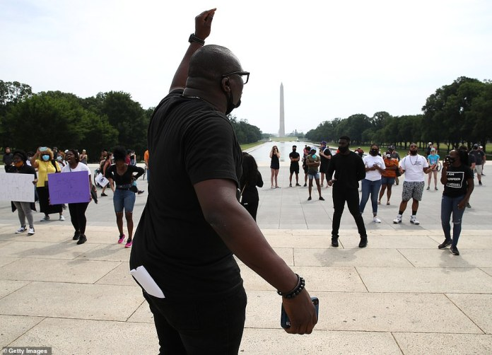 WASHINGTON, D.C .: A group of protesters gathered outside the Lincoln Memorial on Saturday. National monument and others across town are still guarded by the National Guard despite peaceful protests since Tuesday