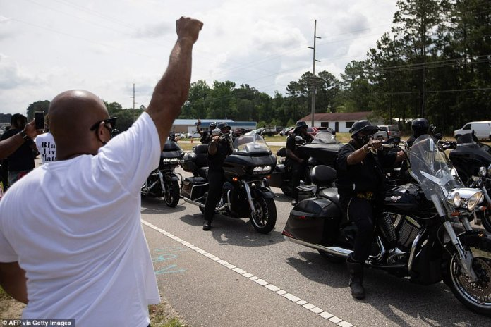 RAEFORD, NORTH CAROLINA: A group of bikers arrives to pay homage to George Floyd at his memorial in North Carolina
